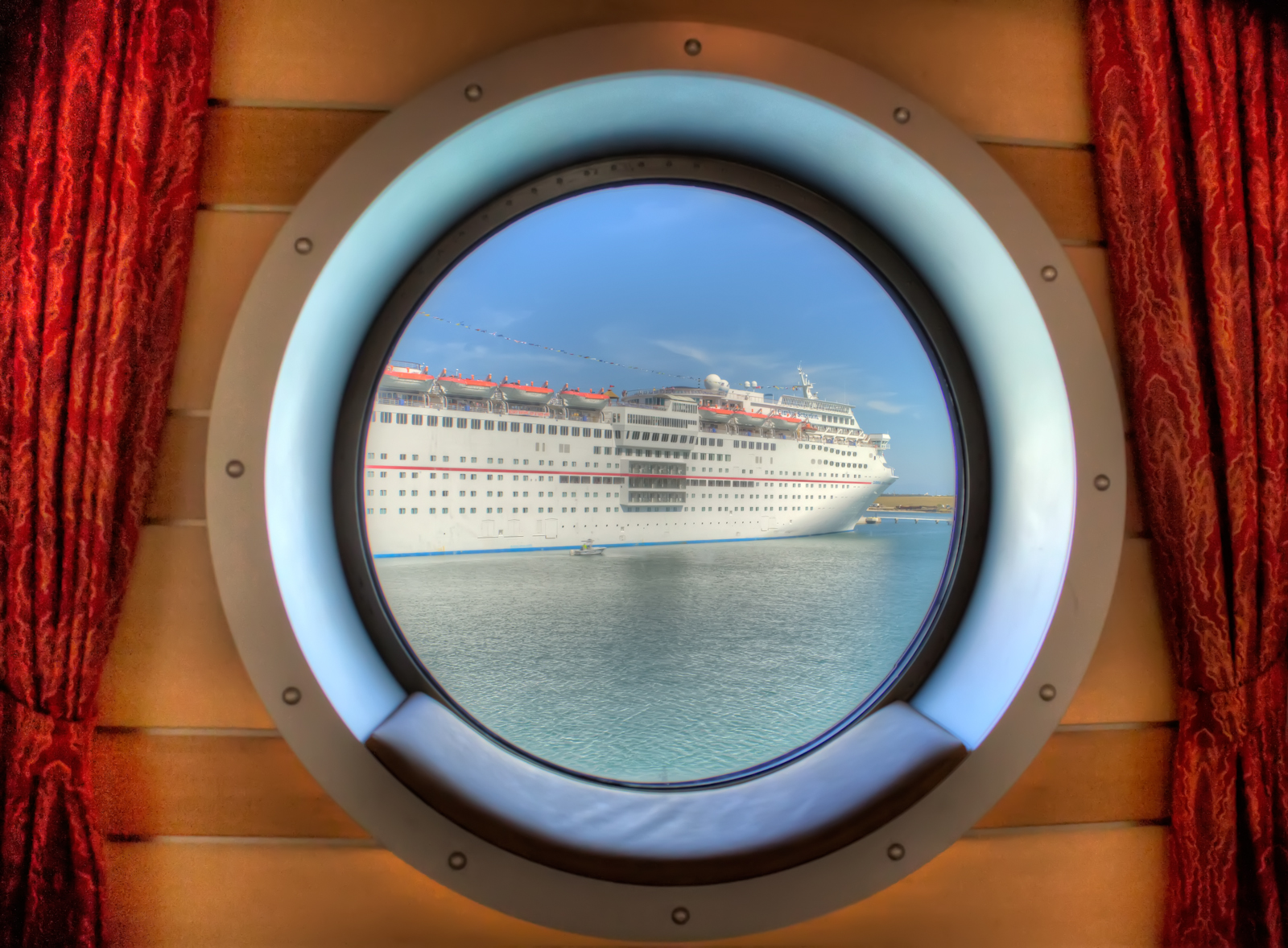 Carnival Sensation through the Porthole
