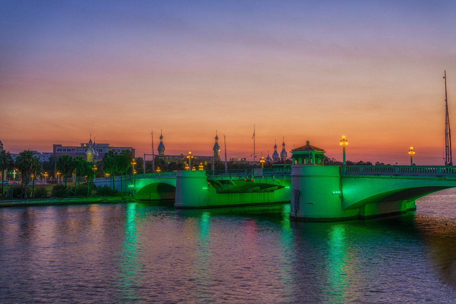 Green Kennedy Bridge and the University of Tampa at Sunset Merge