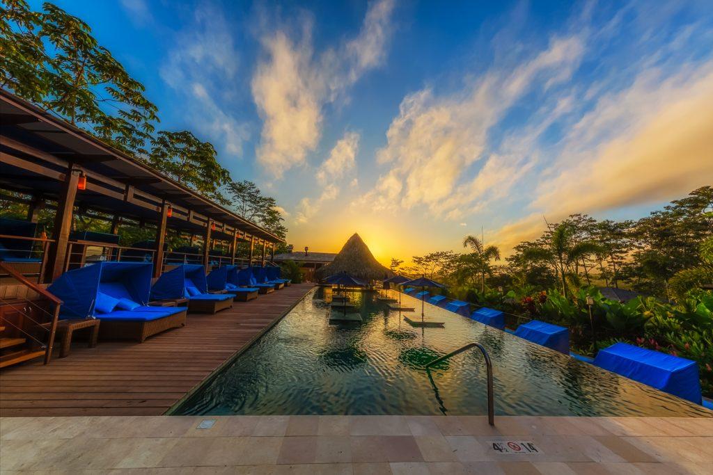 Infinity pool at sunrise, Nayara Hotel, La Fortuna, Costa Rica