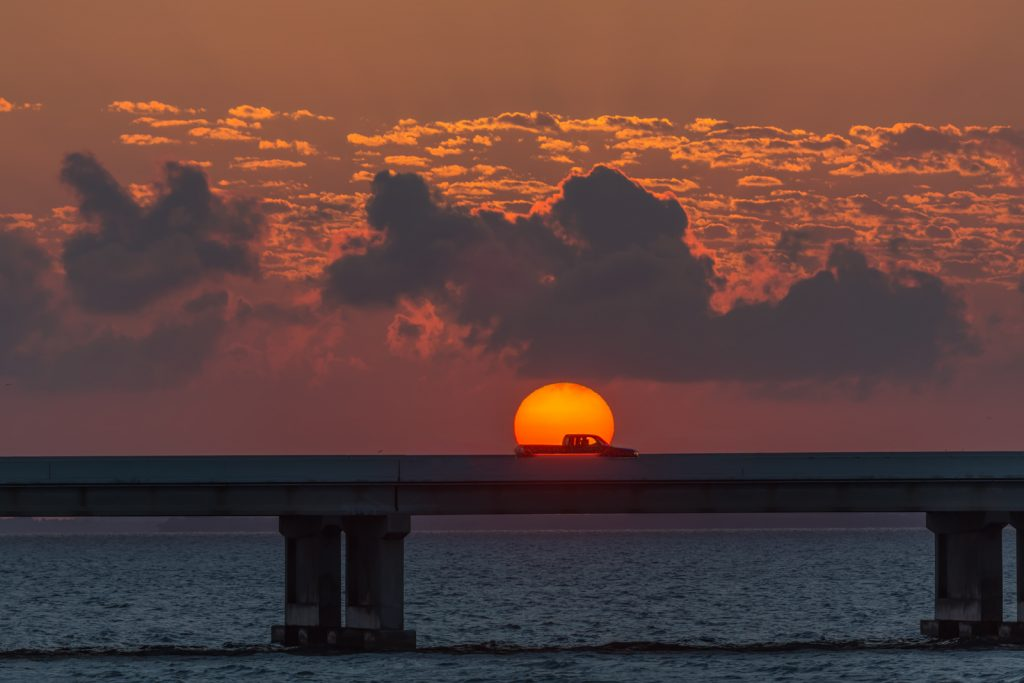 Truck Driving through Sunrise over Skyway Bridge, St Petersburg, Florida