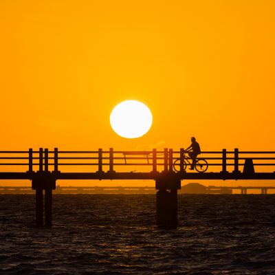 Biker Silhouette at Sunrise on Bay Pier, Fort Desoto, Tierra Verde, Florida